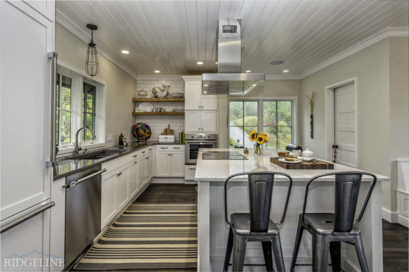 white clean kitchen with grey barstool chairs